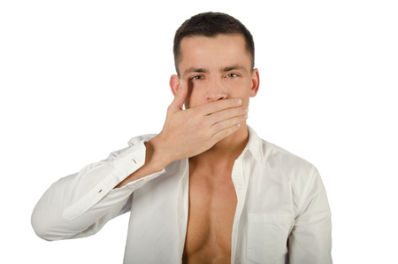 Young handsome guy covers his mouth with his hand. Health problems. Bad breath Stock Photo