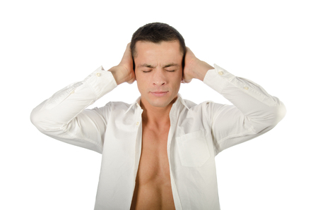 Handsome man closes his ears with his hand. Hear no evil Stock Photo