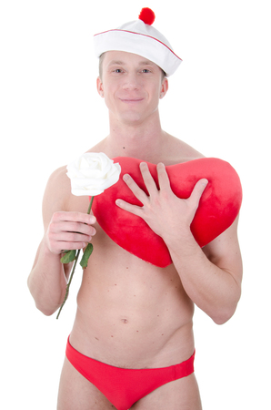 Love and happiness. Attractive man shirtless. Romance and passion. Love and tenderness. Young sexy man holding toy heart. Stockfoto