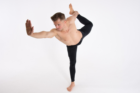 Young handsome man and exercises. Training and relaxation. Healthy lifestyle. Stretching