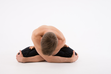 Young handsome man and yoga. Training and relaxation. Healthy lifestyle 版權商用圖片