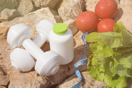 Sport and diet. Vegetables and fresh water. Healthy eating and sports 版權商用圖片