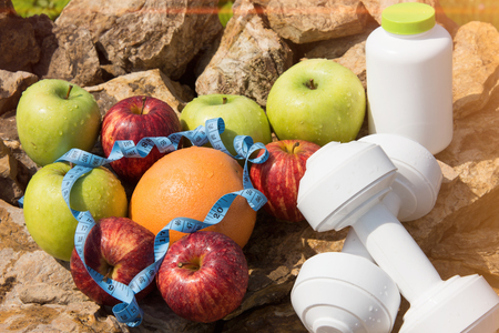 Sport and diet. Fruits and fresh water. Healthy eating and sports 版權商用圖片