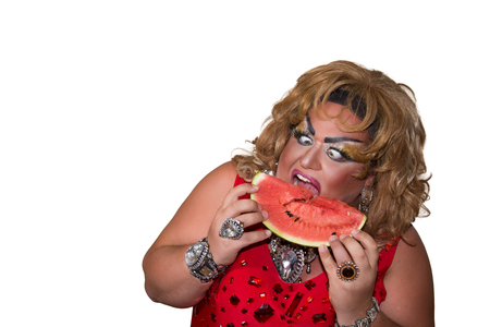 Funny travesty actor. Drag queen in red. Feelings and emotions. Fat man and make-up