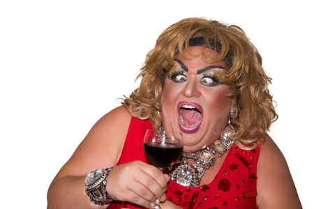 Funny travesty actor. Drag queen and red wine. Feelings and emotions 写真素材 - 105788831