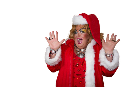 Funny travesty actor. Drag queen in santa costume. Fat man and make-up. Isolated