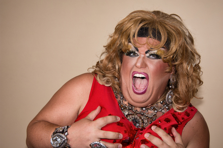 Funny travesty actor. Drag queen in red. Feelings and emotions. Fat man and make-up. Game 写真素材 - 105789842