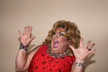 Funny travesty actor. Drag queen in red. Feelings and emotions. Fat man and make-up. Fright 写真素材 - 105789843