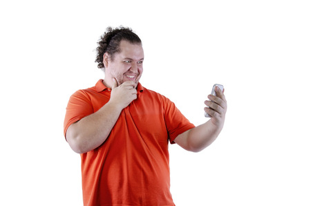 Selfie. Funny man and phone. White background. Isolated