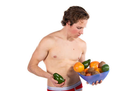 Young attractive guy holding fruits.