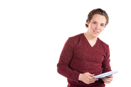 Student on a white background. Young attractive guy and books.