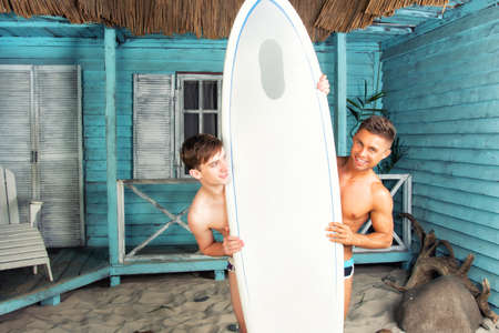 Surfing. Two sexy guys and vacation.