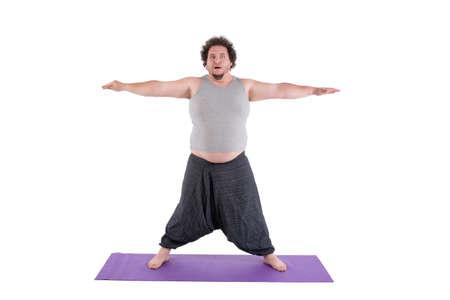 funny yoga and fat man Reklamní fotografie