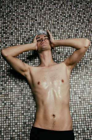 Young attractive guy in the shower