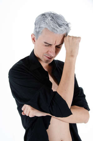 Headache and stress. Young attractive guy. Gray background.