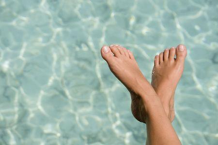 Women foot and tropical lagoon Maldives Stock Photo