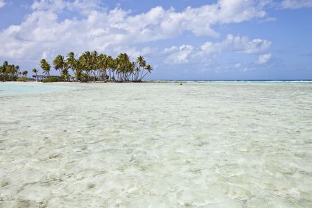 Blue lagoon and translucide water front of a tropical island Stock Photo
