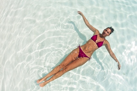 A woman relaxing in water of blue lagoon in Maldives photo