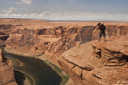 Man take pictures of Horseshoe Bend in Arizona USA
