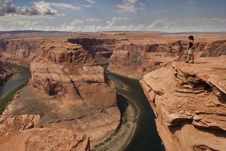Woman look the Colorado river front of Horseshoe Bend in Arizona USA Stock Photo