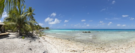Tropical beach of a paradise island panoramic view photo