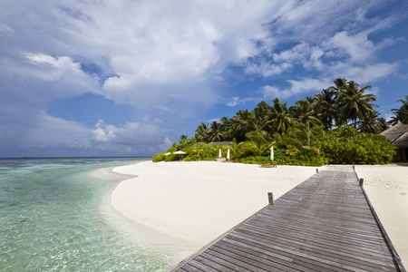 Luxury hotel in tropical island with white sand beach, blue lagoon, ocean view and palm tree
