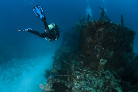 A scubadiver in deep blue of indian ocean  Picture take in Ari atoll - Maldives Stock Photo - 14002125
