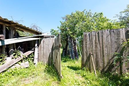 garden gate: Opened garden gate in wooden fence in the Russian village.