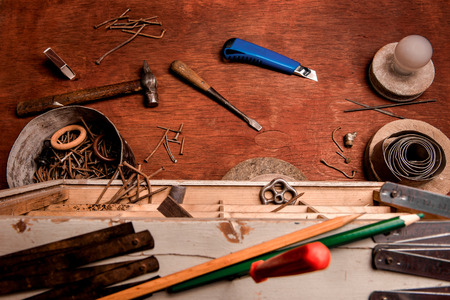 decrepit: Desktop in the home workshop with old decrepit instruments and accessories. The view from the top. Stock Photo