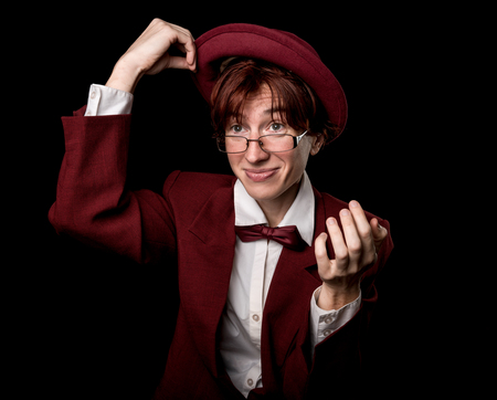 bowler: Strange person in a suit and bowler taking off the hat. Stock Photo