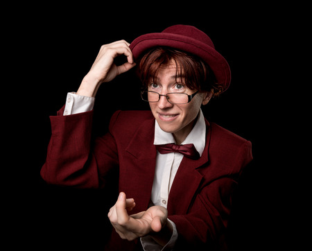 exaggerated: Strange person in a suit and bowler taking off the hat and beckoning somebody by hand.
