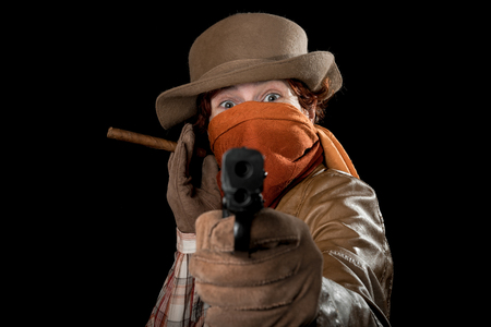sheath: Someone wearing a hat, scarf on face, leather jacket and gloves with a cigar, a knife and a gun.