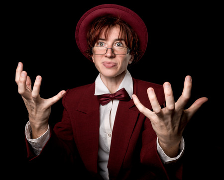 uplifting: Strange person in a suit and bowler  uplifting hands in indignation.
