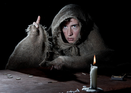 threateningly: Enclosed nun threateningly raising finger in the dark cell.
