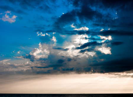 spaciousness: Cloudy sky over the sea in the evening.