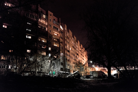 dimly: Moscow, Russia - December 14, 2015: Night street in a residential area dimly lit with lanterns.Editorial illustrative.
