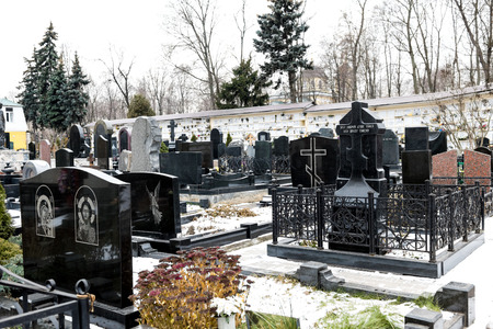 editorial: Moscow, Russia - December 15, 2015: Part of the city Orthodox cemetery on a winter day. Editorial illustrative.