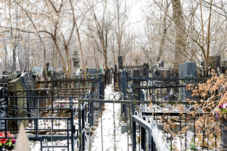 illustrative: Moscow, Russia - December 15, 2015: Part of the city Orthodox cemetery on a winter day. Editorial illustrative.