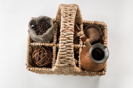 coffee pot: Food basket with coffee and coffee pot. Top view. White background. Stock Photo