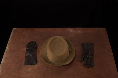 browns: Female wool hat and leather gloves in browns on the table. Stock Photo
