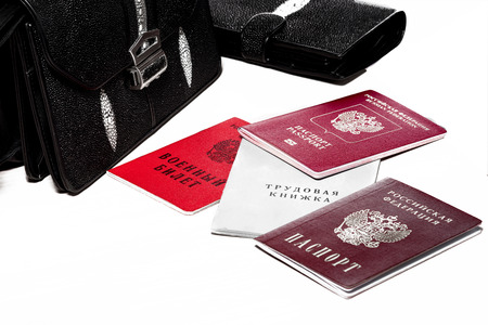 identity card: Set of russian personal documents, purse and wallet at the table.
