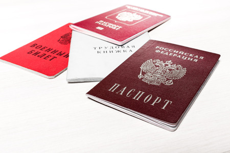 naturalization: Set of russian personal documents at the table.