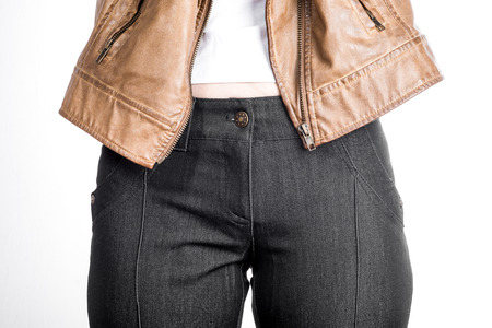 breeches: Front view of female hips in breeches with  white T-shirt and jacket.