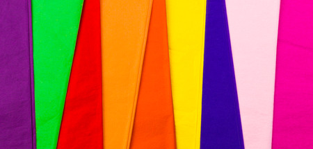 unequal: Colorful sheets of paper tissue folded in a row in the form of unequal strips. Texture. Background image.