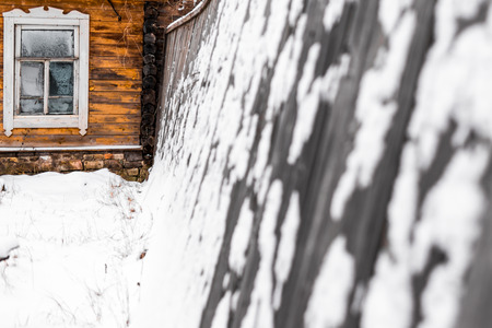 outbuilding: Frozen window in wooden outbuilding in winter. Stock Photo
