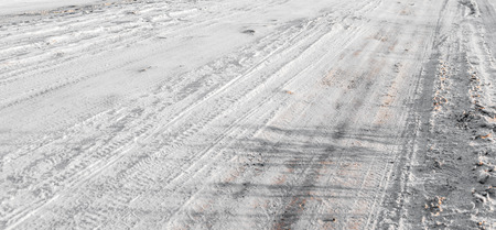 motorcars: Tracks of motor-cars on flat field of snow on a sunny frosty day.