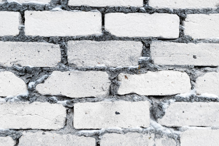 paling: Textural image. Closeup of silica brick wall intersticed with snow. Stock Photo