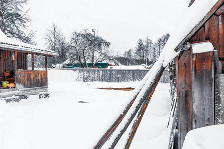 epiphany: Epiphany frosts. Old countryside yard under the snow. Stock Photo