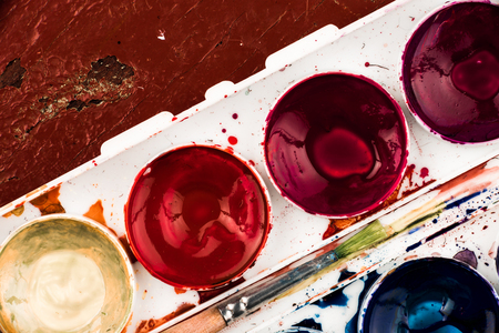 suffusion: Part of box of water colours with paintbrush. Top view. Stock Photo
