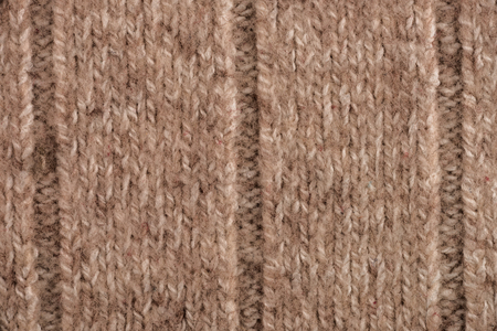 woolen: Textural image. Closeup of woolen machine-knitted fabric.